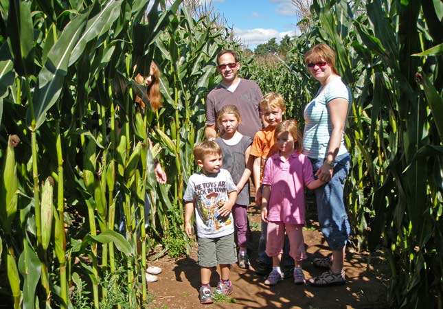 A family visiting the mazes in August
